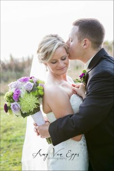 Alyssa & Michael at the Lake Mary Event Center in Lake Mary, Florida. Beautiful flowers by the Oviedo Florist.