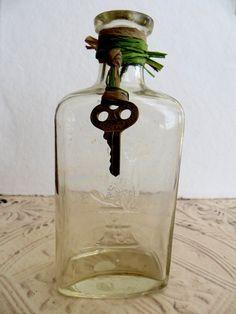 Vintage Antique Medicine Bottle with Skeleton key by tuscanroad