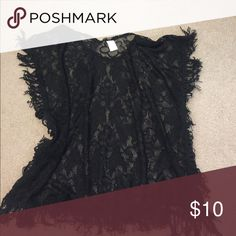 Xhilaration black sheer cover up This is a cute cover up!  It's black sheer lace with fringe. It is hemmed on the sides of the body so it's got real arm holes. True to size, if not a little oversized. Never worn, but no tags. Xhilaration Swim Coverups