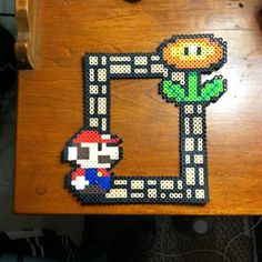 Mario frame perler beads by qootielynn perler,hama,square pegboard,video games,nintendo,mario,