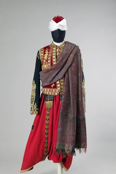 Russian Court Blackamoor's Uniform Place of creation: Russia Date: Late 19th - early 20th century School: St Petersburg Material: cloth, satin, velvet, galloon and metal thread Technique: embroidered Dimension: l.: jacket 54,camisole 45,breeches 117,belt 341 cm