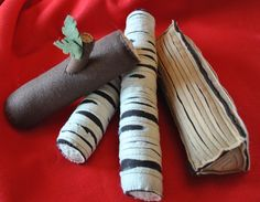 """Felt """"firewood"""" logs. Love the simplicity of this...I bet my kids could find a ton of ways to play with it."""