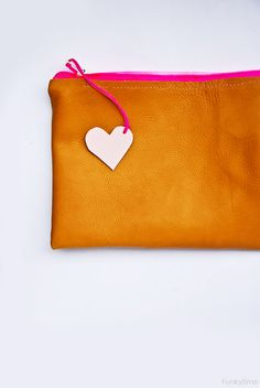simple leather pouch--love the zipper pull idea!  DIY: summer leather pouch