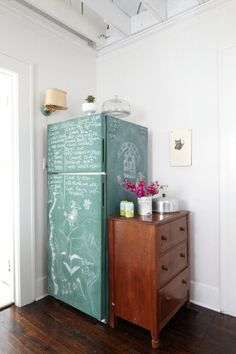 Teal colored chalkboard paint on refrigerator with a beverage center station on a small dresser can be used for a temporary makeshift Kitchen during a major renovation or remodel