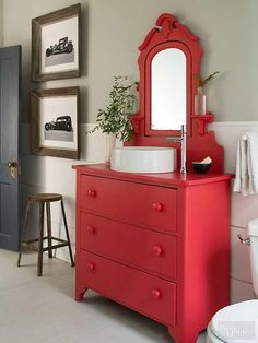 This elegant vanity was sanded, primed, and painted red to achieve an eye-catching look. A white vessel sink continues the neutral bathroom color scheme, while an off-center faucet emphasizes its originality. Diy Bathroom Vanity, Bathroom Red, Rustic Bathroom Vanities, Rustic Bathrooms, Bathroom Cabinets, Brick Bathroom, Tile Bathrooms, Bathroom Stuff, Bathroom Small