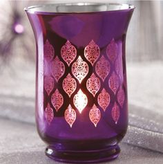 Three Moroccan Inspired Candles placed on a bedside table would be a good feature to my Moroccan Themed Bedroom. Maybe three different colours placed together in different size orientation, the colours will consist of Blue, Purple and Pink