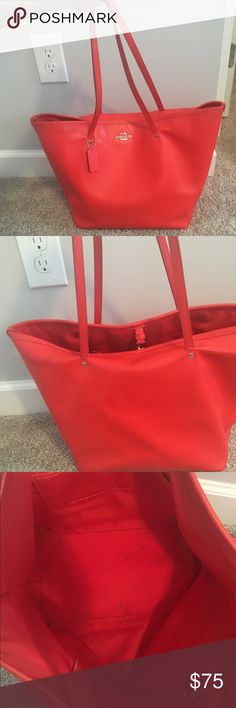Coach Bucket Bag Carried several times but the exterior is still in good condition. Beautiful coral red color. Smoke free home. Coach Bags Totes