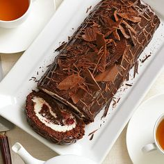 Calling all chocolate lovers! This Black Forest Cake Roll is made with four kinds of chocolate! More of our best chocolate cake recipes: http://www.bhg.com/recipes/desserts/cakes/chocolate-cakes/?socsrc=bhgpin072213forestcakeroll=11