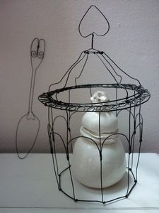 uh, I love this wire cloche framing a special item..... CUTE wire spoon art