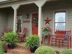 Americana porch. Paint door and black iron table and chairs same color. Red