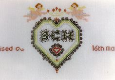 Baptism Sampler. Cross stitch worked on 28-count evenweave fabric. Detail of heart.