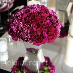 Perfect dark pink: http://weddings.theknot.com/Real-Weddings/71382/detailview.aspx?type=3&id=71382&STOPREDIRECTING=TRUE&wedding%20details=Bridal%20Bouquets,Bridesmaid%20Bouquets,Centerpieces&colors=pink&pageIndex=5