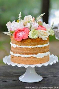 Gorgeous flower-topped cake. Would be lovely at a summer birthday party!