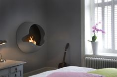 Cupola by Vauni This wall-mounted globular fireplace lends futuristic flair to any living room.