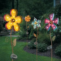 Unlike your real flowers, these lighted metal ones will live from season to season! They are a low maintenance way to add color and personality to your garden. Each features brightly colored petals and green leaves. These yard decorations are available in 4 shapes and sizes and shine bright at night with a full day's sun charge. Use them to line a walkway or scatter them among your live flowers to shine some light on your beds at night. Each easily stakes into the ground.