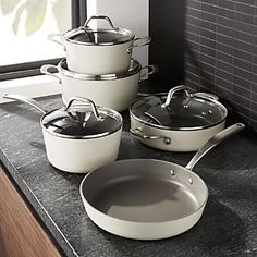 Shop Fleischer and Wolf Monaco Morning Cookware Set. Clad in cream for a fresh, bright look, this nine-piece aluminum cookware set provides an easy-to-use, easy-to-clean cooking experience. Cast Iron Cookware, Cookware Set, Kitchen Hacks, Kitchen Tools, Kitchen Products, Kitchen Supplies, Kitchen Utensils, Kitchen Dining, Kitchen Decor