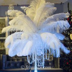 DIY: How To Make Feather Centerpieces (plus 7 variations) I have used different variations of these DIY ostrich feather centerpieces instead of floral arrangements at all kinds of wedding receptions and parties.a Great Gatsby party, Winter Wonderland Great Gatsby Themed Party, Great Gatsby Wedding, 1920s Party Themes, Harlem Nights Theme Party, 1920 Theme, 1920s Wedding, Ostrich Feather Centerpieces, Floral Centerpieces, Feather Wedding Centerpieces