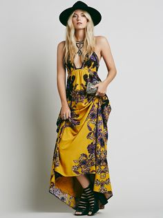 Cantik Maxi Dress | Beautifully hand crafted in Bali maxi dress featuring a floral print with applique detailing. Strappy front with keyhole opening at the bust. Adjustable straps in back. Lined.