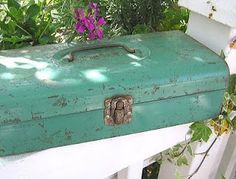 Turquoise rusty tool box.