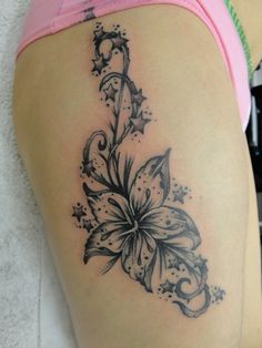 Flower Thigh Dezine Tattoo Pictures at Checkoutmyink.com