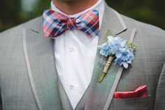 blue wedding boutonniere http://www.weddingchicks.com/2013/10/23/north-carolina-wedding/