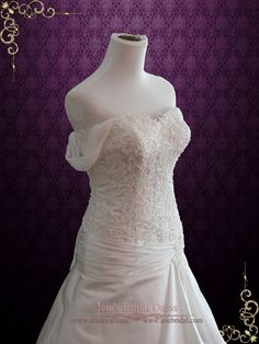 Beautiful drop waist lace wedding dress made with unique satin lace, accented with beadings on the bodice. Photoed in ivory. This dress can also be made in white. Working Time: 13 -16 weeks Rush Order