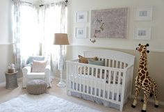 A gender neutral travel-themed nursery - so beautiful and peaceful & nice placement of area rug.