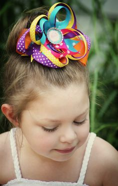 Mia Modeling an OTT Barbie bow for Charm city Chic couture