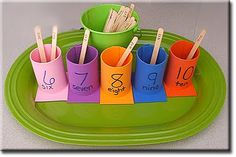 addition math center:  put an addition problem on the stick and then the students match the addition problem to the answer on the cups. Lends itself to using much larger numbers.