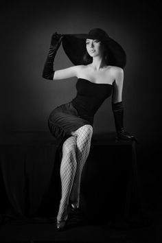 She harkened back to an earlier time, and reminded me mostly of a film noir femme fatale. via stockingobsessed: ella9