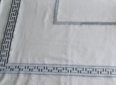 Table cloth in high grade medium weight white cotton with gray Greek Key pattern for a classic yet modern table decor. This table linen sets the