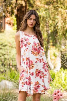 """Details: A lovely floral a-line mini dress featuring sleeveless, a round neck, side pockets and swing hem. Content + Care 95% Polyester 5% Spandex Hand wash cold Made in U.S.A Size + Fit Model is 5'7"""""""