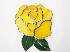 This is a beautiful large yellow rose made using an opaque yellow stained glass and adorned with two bright green stained glass leaves. This piece measures 7 high by 5 wide. All of my pieces are done Stained Glass Flowers, Stained Glass Designs, Stained Glass Panels, Stained Glass Patterns, Stained Glass Art, Glass Fusing Projects, Stained Glass Projects, Beautiful Pink Roses, Translucent Glass