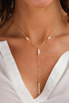 """The best-selling Galactic Bar Necklace's new sister! A dainty statement Y-style necklace with a trio of natural freshwater pearls and a flat modern vertical bar drop. Necklace measures approx. 18"""" in length with a 3"""" drop. Looks great layered with a smaller necklace on top. Perfect for beach weddings! From Christine Elizabeth Jewelry Closure: Lobster clasp. Choose your material Measures 18"""" + a 2"""" extender + 3"""" drop. Handmade in Corning, NY"""