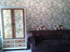 Using similar wallpaper inside a cupboard turns out to be a great idea!