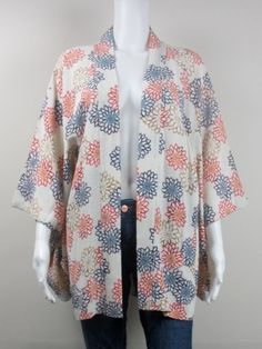 Here's another one of our delectable Japanese vintage kimono jackets - this ones in an amazing feeling silk crepe with a very cool faded Crysanthemum print. Again in beautiful condition and only £210. This one looks awesome over denim cut-off shorts... complete with bronzed legs and sandles, of course!