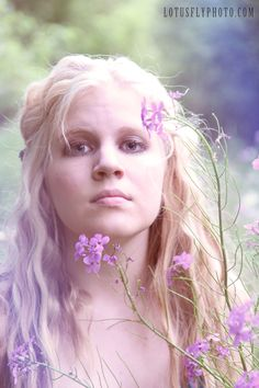 I love this floral portrait from a recent portrait photoshoot with a beautiful young model. I love incorporating nature into all of my shoots!    floral, pink, purple, flowers, girl, blonde, portrait photography, Milwaukee photographer, LotusFly Photography