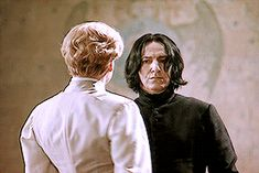 """2002 -- Kenneth Branagh as Professor Gilderoy Lockhart and Alan Rickman as Professor Severus Snape in """"Harry Potter and the Chamber of Secrets."""" This little GIF is from the dueling clup Professor Lockhart tried to get started."""
