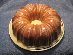 LEMON BUNDT CAKE (from America's Test Kitchen) - 3 lemons , zest grated, then LEMONS juiced for 3 tablespoons juice  3 cups unbleached all-purpose flour  1 teaspoon baking powder  1/2 teaspoon baking soda  1 teaspoon table salt  1 teaspoon vanilla extract  3/4 cup buttermilk  3 eggs , at room temperature  1 egg yolk , at room temperature  2 1/4 sticks (18 tablespoons) unsalted butter  2 cups sugar; Glaze  2 - 3 tablespoons fresh lemon juice  1 tablespoon buttermilk  2 cups confectioners' sugar