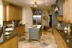 What To Do With Oak Cabinets — DESIGNED w/ Carla Aston. Pretty rustic kitchen with oak cabinets. This might go best with what I have in mind for the living room? Honey Oak Cabinets, Oak Kitchen Cabinets, Kitchen Paint, Kitchen Redo, Kitchen Flooring, Kitchen Countertops, New Kitchen, Kitchen Furniture, Kitchen Ideas