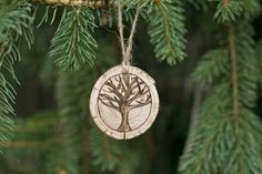 Hand cut wooden circles from naturally fallen trees in the Gracemere Woods. Each of our ornaments are inspired by the spirit of the forest, and