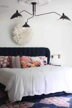Navy blue tufted headboard in a navy, white, and pick bedroom. No Makeup Home Tour hosted by House of Hipsters — what a blogger's home looks like in real life.