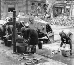 Berlin housewives washing clothes at a water hydrant, 1945