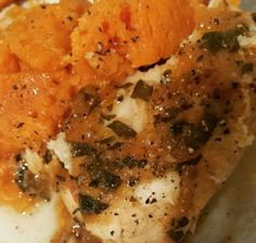 Baked fish with a tomato and basil sauce served with steamed sweet potato