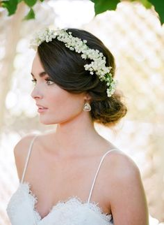 soft wedding updo with a floral crown / http://www.deerpearlflowers.com/spring-summer-wedding-hairstyles/