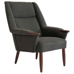 Danish Modern High-back Lounge Chair | From a unique collection of antique and modern wingback chairs at https://www.1stdibs.com/furniture/seating/wingback-chairs/