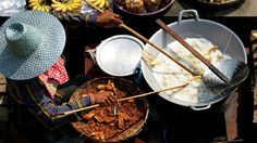 Thanks to favorite-places-spaces.... A cook stirs up some Thai food in Bangkok