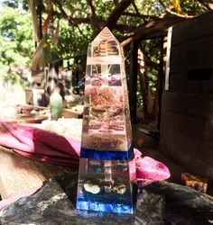 A one of kind Violet Flame Orgone obelisk, hand made with love, over the Pisces Harvest Full Moon, 2016. 7.5 tall, this orgonite obelisk manifested by meditation on the healing power of the waters and pure surrender to Spirit. An equally beautiful and energetically powerful work of art to inspire transformation in your space. A copper spiral floats at the tip of this orgone generator to magnify the healing energy released from this organite. A selenite wand floats throughout the entire…