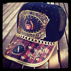 3e43af752a4 This dog is tied with golden chains. Xtress hats now at O-Concept Store.