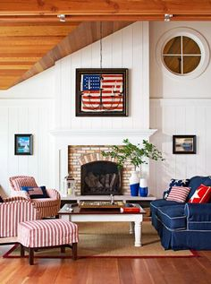 Michigan cottage: A framed American flag from 1837 the year Michigan became a state inspired this living room's red white and blue color scheme. More photos from this home: www. Americana Living Rooms, Living Room Red, Coastal Living Rooms, Shabby Chic Living Room, Living Room Decor, Cottage Living, Living Furniture, Country Living, Living Area
